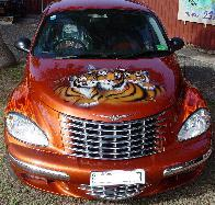 Airbrushed Tiger Murals and realistic flames on PT Cruiser.